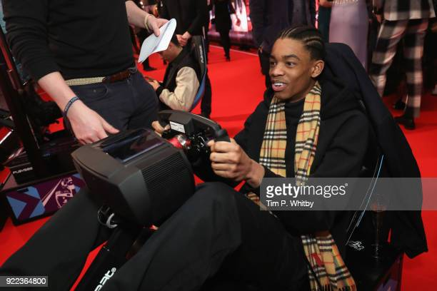 Montell Martin competes on the Formula E Simulators at the BRITS official aftershow party in partnership with Tempus Magazine at the Intercontinental...