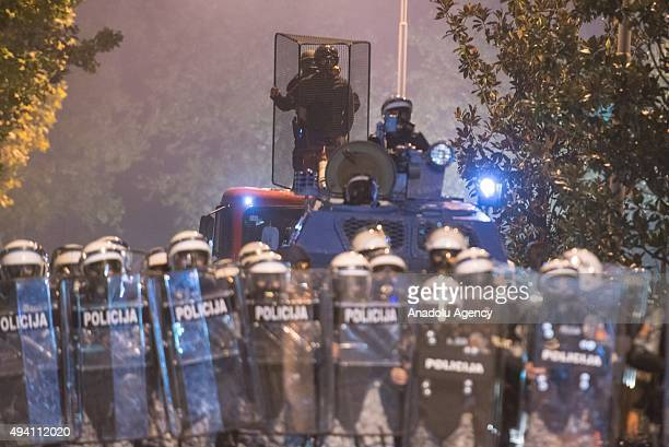 Montenegrin police use tear gas to disperse the protesters as thousands of opposition supporters take part a protest rally calling for the prime...