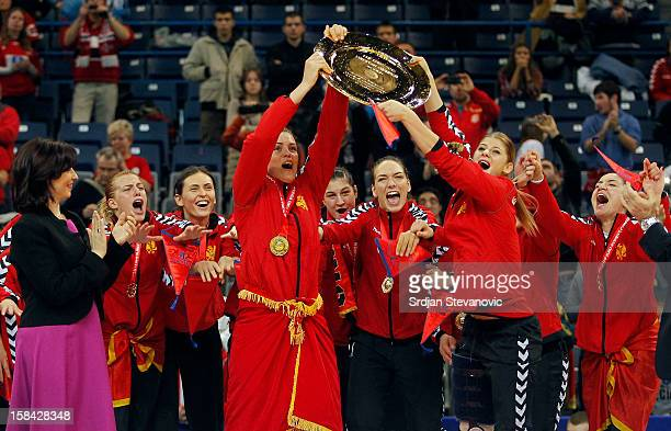 Montenegro handball team celebrate their gold medal win during the Women's European Handball Championship 2012 medal ceremony at Arena Hall on...