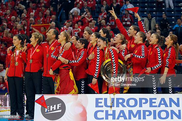 Montenegro handball team listen to their national anthem during the Women's European Handball Championship 2012 medal ceremony at Arena Hall on...