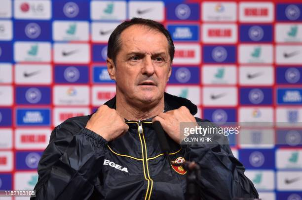 Montenegro manager Faruk Hadibegi attends a press conference at Wembley Stadium London on November 13 2019 on the eve of their Euro 2020 football...