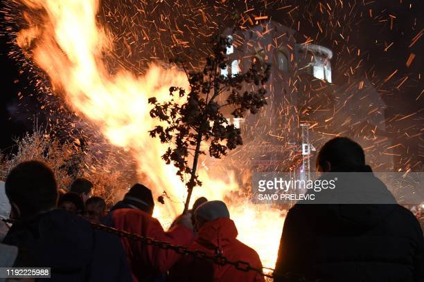 Montenegro Orthodox believers attend a ceremonial burning of dried oak branches symbolising the Yule log during Orthodox Christmas eve celebrations...