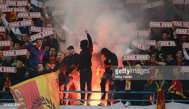 Montenegro supporters show their support during the FIFA 2014 World Cup Group H Qualifier between Montenegro and England at City Stadium on March 26...