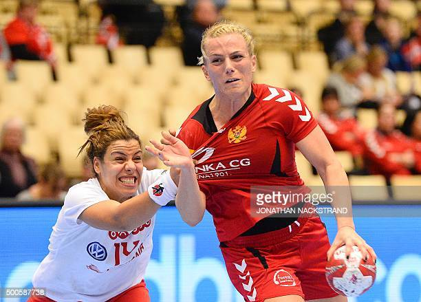Montenegro's Andrea Klikovac vies with Tunisia's Mouna Jlezi during the 2015 Women's Handball World Championship group A match between Montenegro and...