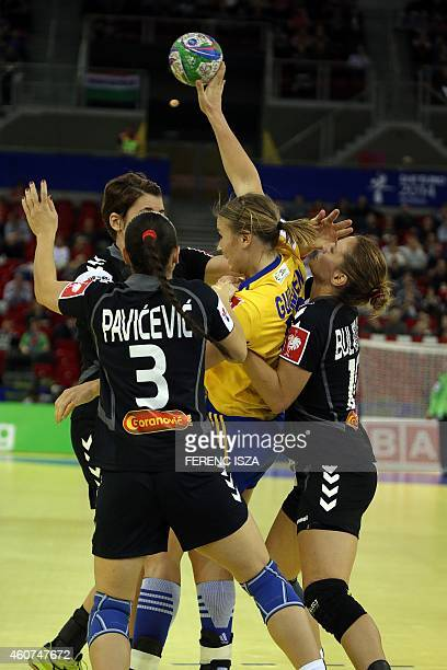 Montenegro's Biljana Pavicevic and Andjela Bulatovic fight for the ball with Sweden's Isabelle Gullden during the bronze medal match of the Women's...