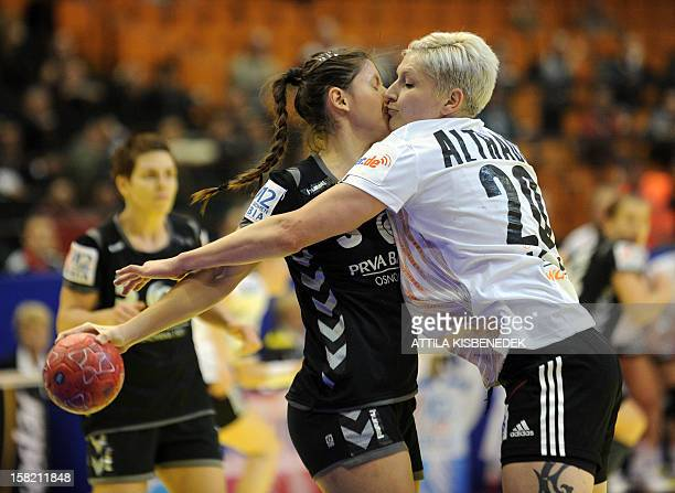 Montenegro's Biljana Pavicevic and Germany's Anja Althaus fights for the ball during the 2012 EHF European Women's Handball Championship Group II...