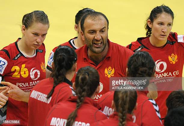 Montenegro's coach Dragan Adzic directs his team during the 2012 EHF European Women's Handball Championship final match against Norway on December 16...