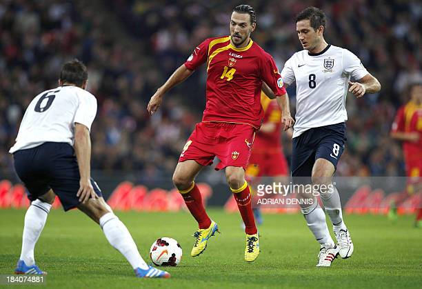 Montenegro's Dejan Damjanovic runs with the ball in front of England's Frank Lampard during the World Cup 2014 Group H Qualifying football match...