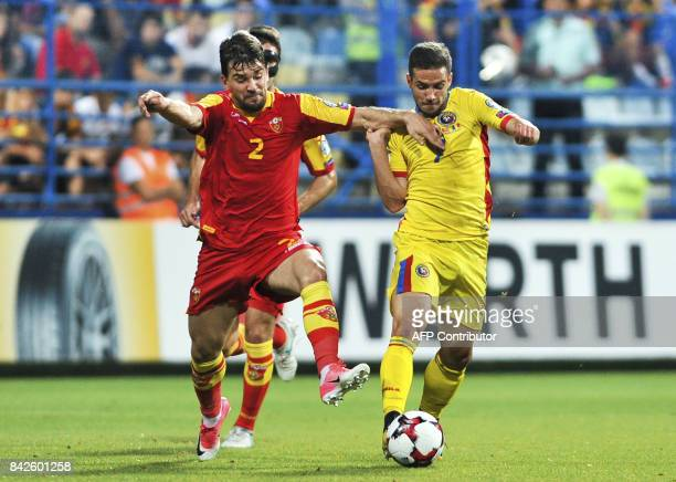 Montenegro's Filip Stojkovic vies with Romania's Alexandru Chipciu during the FIFA 2018 World Cup football qualifier match between Montenegro and...