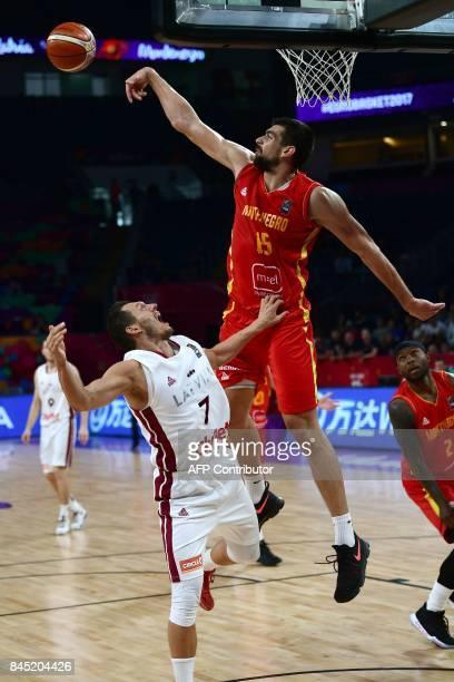 Montenegro's forward Filip Barovic vies with Latvia's guard Davis Bertans during FIBA Eurobasket 2017 men's round of 16 basketball match between...