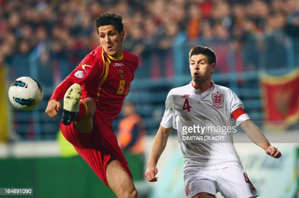 Montenegro's forward Stevan Jovetic vies with England's midfielder Steven Gerrard during their World Cup 2014 qualification football match at...