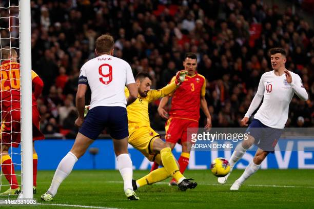 Montenegro's goalkeeper Milan Mijatovic clears the ball during the UEFA Euro 2020 qualifying first round Group A football match between England and...