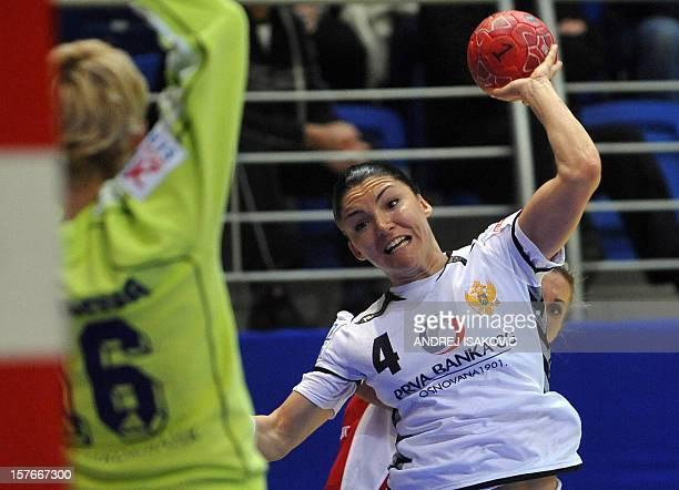 Montenegro's Jovanka Radicevic challenges Russia's goalkeeper Maria Sidorova during the Women's EHF Euro 2012 Handball Championship match Russia vs...