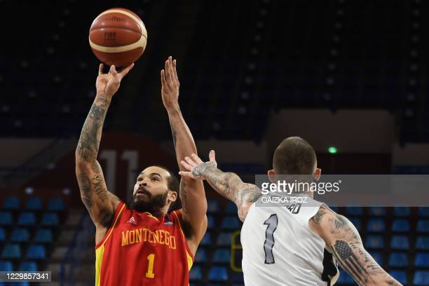 Montenegro's Justin Latrell Cobbs fights for the ball with Great Britain's Ben Mockford during the Eurobasket 2020 basketball match between...