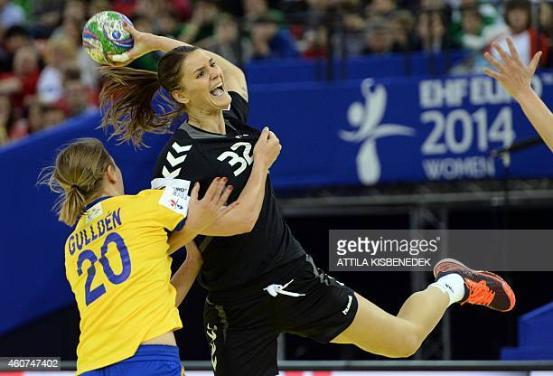 Montenegro's Katarina Bulatovic vies with Sweden's Isabelle Gulldén during the bronze medal match of the Women's European Handball Championship on...