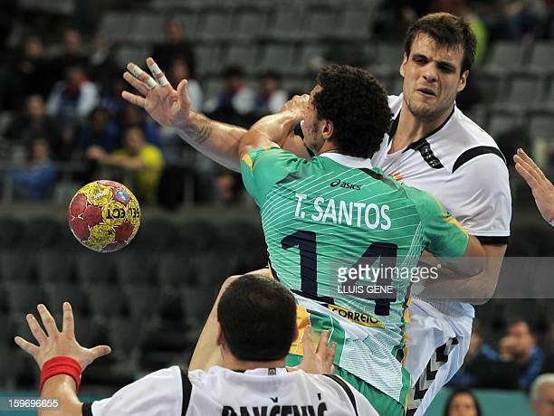 Montenegro's left back Vasko Sevaljevic vies with Brazil's left back Thiagus Santos during the 23rd Men's Handball World Championships preliminary...