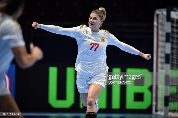Montenegro's left wing Majda Mehmedovic celebrates a goal during the Women Euro 2018 handball Championships Group 1 main round match between Serbia...