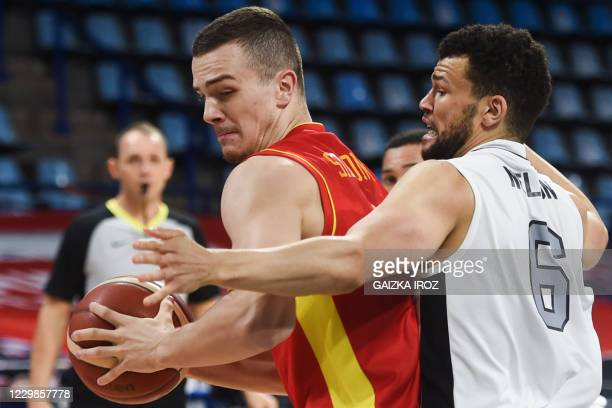 Montenegro's Marko Simonovic fights for the ball with Great Britain's Luke Nelson during the Eurobasket 2020 basketball match between Montenegro and...