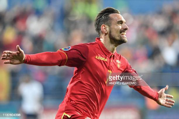 Montenegro's midfielder Marko Vesovic celebrates after scoring the first goal of the Euro 2020 football qualification match between Montenegro and...