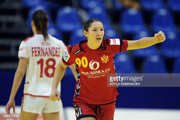 Montenegro's Milena Knezevi celebrates after scoring against Spain's Begona Fernandez during the 2012 EHF European Women's Handball Championship...
