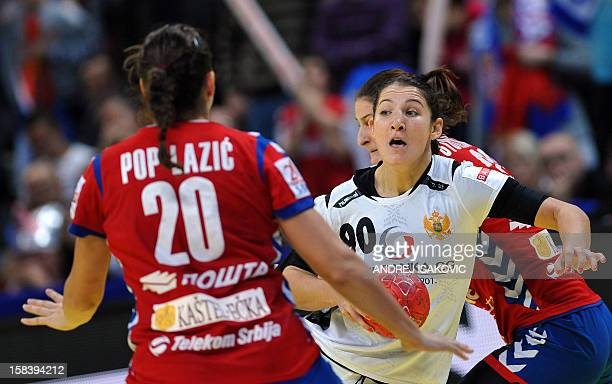 Montenegro's Milena Knezevic fights for the ball with Serbia's Sladjana Pop-Lazic on December 15, 2012 during a women's EHF Euro 2012 Handball...
