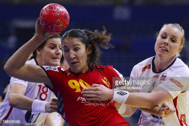 Montenegro's Milena Knezevic throws the ball past Norway's LinnKristin Riegelhuth Koren and Karoline Dyhre Breivang during the 2012 EHF European...