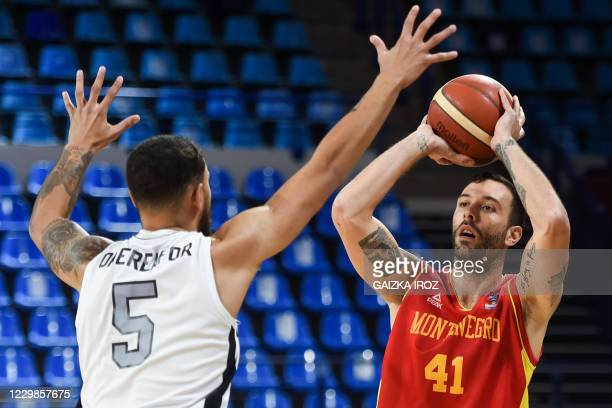Montenegro's Nemanja Vranjes fights for the ball with Great Britain's Teddy Okereafor during the Eurobasket 2020 basketball match between Montenegro...