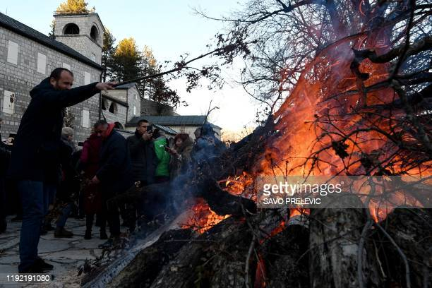 Montenegro's Orthodox believers attend a ceremonial burning of dried oak branches the Yule log symbol for the Orthodox Christmas Eve celebrations in...