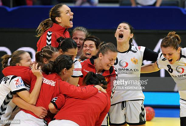 Montenegro's players celebrate their victory over Serbia after the 2012 EHF European Women's Handball Championship semifinal match on December 15 at...