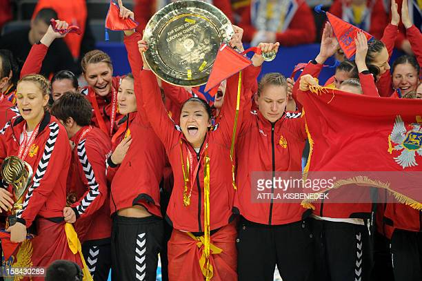 Montenegro's players celebrate with the trophy after they won the 2012 EHF European Women's Handball Championship on December 16 at the Kombank Arena...