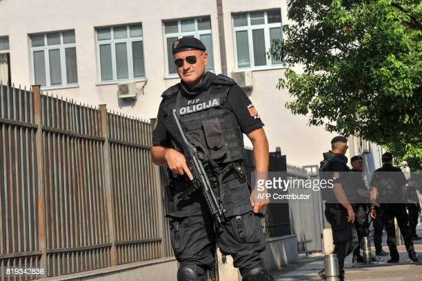 Montenegro's police officers stand guard outside the courthouse during the trial of Montenegro Democratic Front leaders Andrija Mandic and Milan...