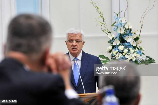 Montenegro's Prime Minister Dusko Markovic speaks to the parliament in Cetinje during a discussion on NATO membership agreement on April 28 2017...