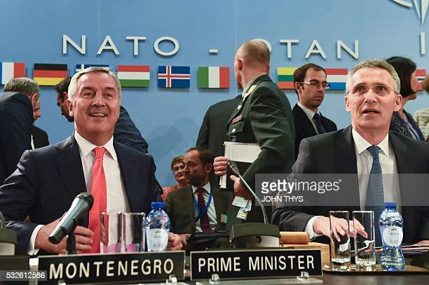 Montenegro's Prime Minister Milo Dukanovic attends a NATO Foreign minister meeting next to NATO Secretary General Jens Stoltenberg at the NATO...