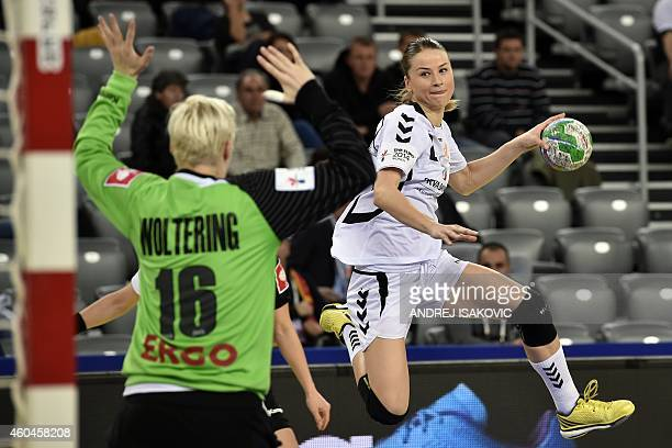 Montenegro's Radmila Petrovic challenges Germany's goalkeeper Clara Woltering during the Main Round Group 2 match Germany vs Montenegro of the 2014...