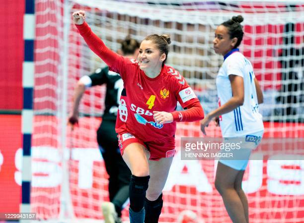 Montenegro's Right winger Jovanka Radicevic celebrates scoring during the preliminary round match between France and Montenegro of the 2020 EHF...
