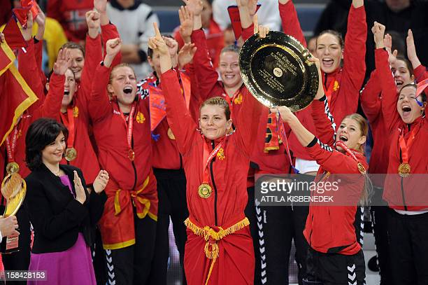 Montenegro's rightwing Jovanka Radicevic and teammates celebrats with the trophy after they won the 2012 EHF European Women's Handball Championship...