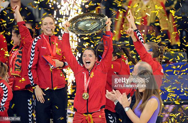 Montenegro's rightwing Jovanka Radicevic celebrates with the trophy after her team won the 2012 EHF European Women's Handball Championship on...