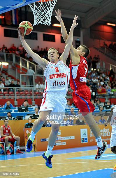 Montenegro's Sead Sehovic vies with Serbia's Bogdan Bogdanovic during the EuroBasket 2013 Group B match between Montenegro and Serbia in Jesenice on...