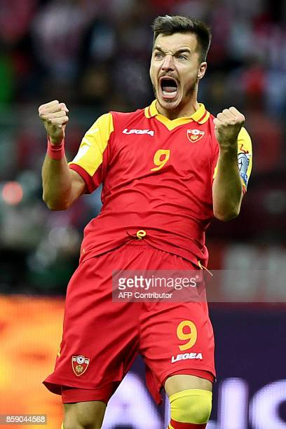 Montenegro's Stefan Mugosa celebrates after scoring during the FIFA World Cup 2018 qualification football match between Poland and Montenegro in...
