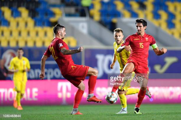 Montenegro's Stefan Savic and Marko Simic in action against Romania's Alexandru Maxim during UEFA Nations League 2019 Final Tournament match between...