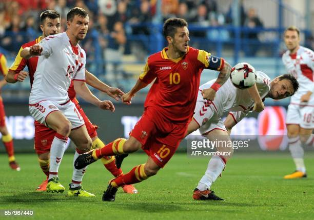 Montenegro's Stevan Jovetic fights for the ball with Denmark's William Kvist during the FIFA WC 2018 Group E football qualification match between...