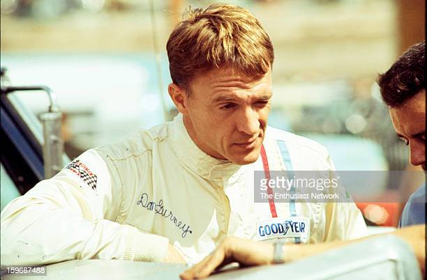 Monterey Grand Prix Laguna Seca CanAm AAR founder and driver Dan Gurney stands by the paddock Gurney would qualify his his Chevrolet powered McLaren...