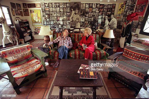 LSMonterey10403bcd–––Surrounded by movie memorabilia and Monterey furniture Jack Emrek and Sue Ane Langdon sit in den of their Hidden Hills home...