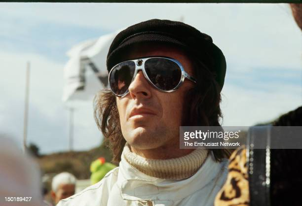 MontereyCastrol Grand Prix Laguna Seca CanAm Race car driver Jackie Stewart wearing sunglasses and cap in the pit area