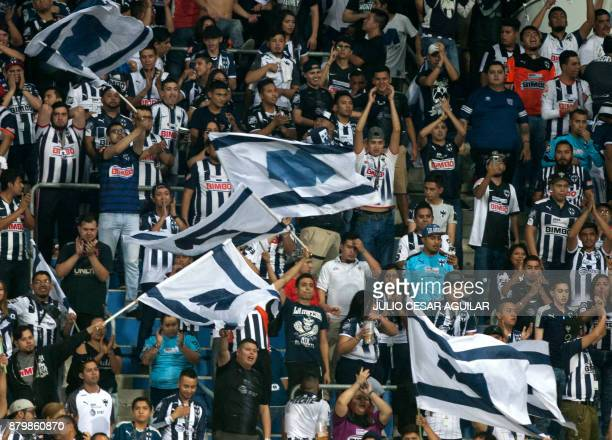Monterrey fans cheer for their team during their quarter final Mexican Apertura 2017 tournament football match against Atlas at the BBVA Bancomer...