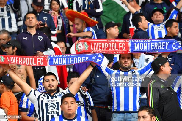 Monterrey fans wave scarves ahead of the 2019 FIFA Club World Cup semifinal football match between Mexico's Monterrey and England's Liverpool at the...