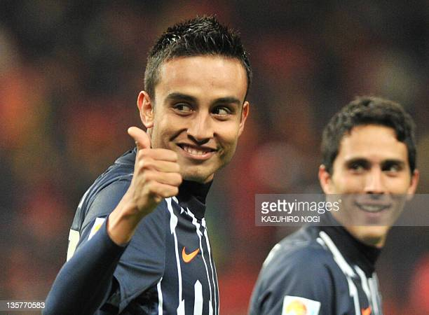 Monterrey player Jesus Zavala acknowledges fans after he scored against Tunisian club team Esperance in their fifth place playoff football match...