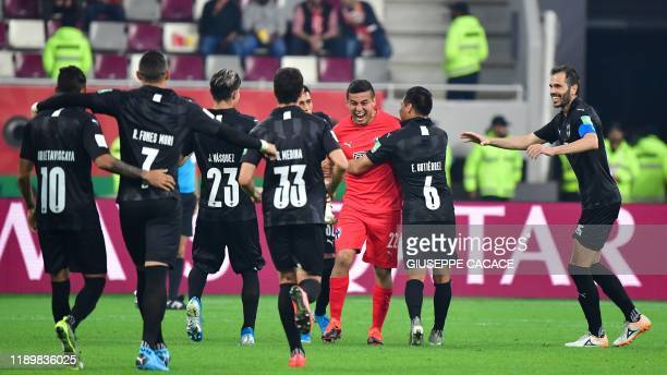 Monterrey players congratulate goalkeeper Luis Cardenas after he scored a goal during the 2019 FIFA Club World Cup 3rd place playoff football match...