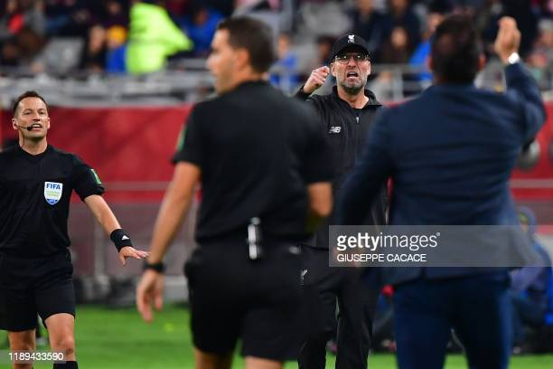 Monterrey's coach Antonio Mohamed argues with Liverpool's German manager Jurgen Klopp during the 2019 FIFA Club World Cup semifinal football match...