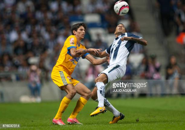 Monterrey's Jürgen Damm vies for the ball with Tigres' Leonel Vangioni during the 2017 Mexican Apertura tournament football match in Monterrey Mexico...